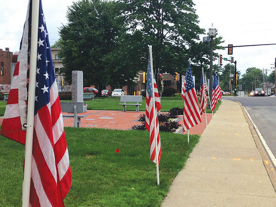The city still showed signs of patriotism with the lineup of American flags at City Park.