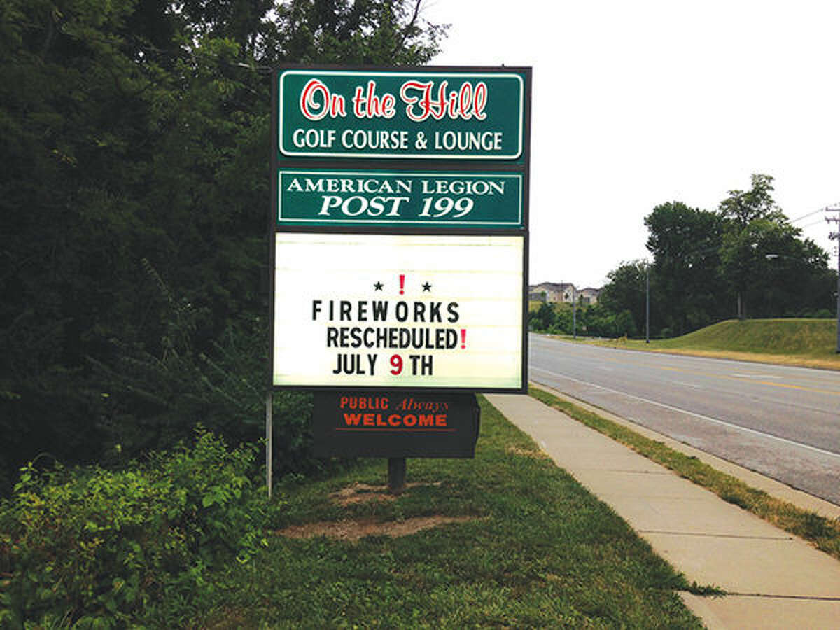 Organizers of the annual Fourth of July celebration at Edwardsville American Legion Post 199 changed their sign board Saturday to reflect the event's rescheduling. Weekend rains pushed the fireworks display and other events back one week.