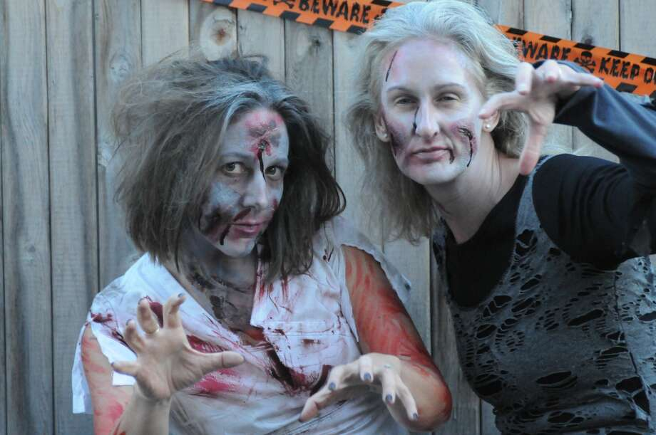 Thirty-seven moms took to a Fairfield neighborhood in full zombie attire  on Halloween night 2016 to recreate Michael Jackson's Thriller video. Photo: Stacey Scruggs