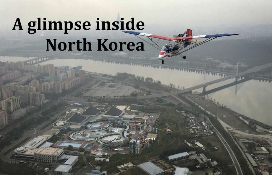 An ultralight aircraft flies over the city of Pyongyang on Sunday, Oct. 16, 2016, in North Korea. Photo: Wong Maye-E/Associated Press