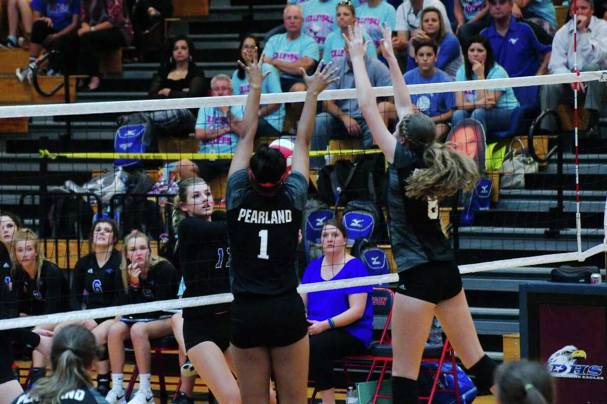 Friendswood's Faith Marabella (11) tries to hit a shot past Pearland's April Conant (1) and Pearland's Victoria Kenny (8) Tuesday, Nov. 1.
