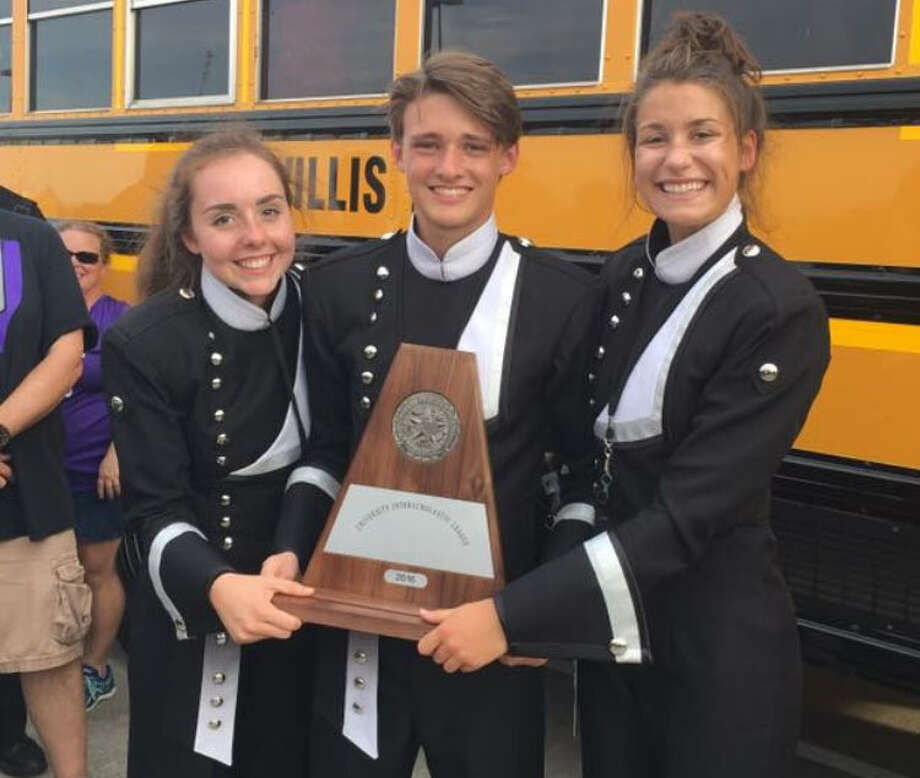 The Willis High School marching band wrapped up a successful competition      season beginning with Division I ratings from all three judges at the      Region IX UIL High School Marching Band contest Oct. 25 at Conroe ISD's      Woodforest Stadium. Sophomore Drum Major Victoria Jungwirth, Junior Drum Major Andrew Funnell, and Senior Drum Major Katelyn Barry holds a trophy on UIL day. Photo: Submitted Photo