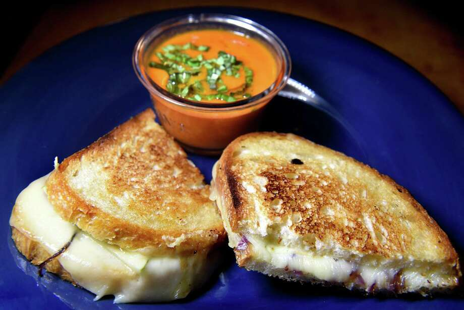 For National Grilled Cheese Day, you could whip up a sandwich with a side of soup at home, or try these Capital Region cheese specialties. Keep clicking for suggestions. Photo: Cindy Schultz / Albany Times Union