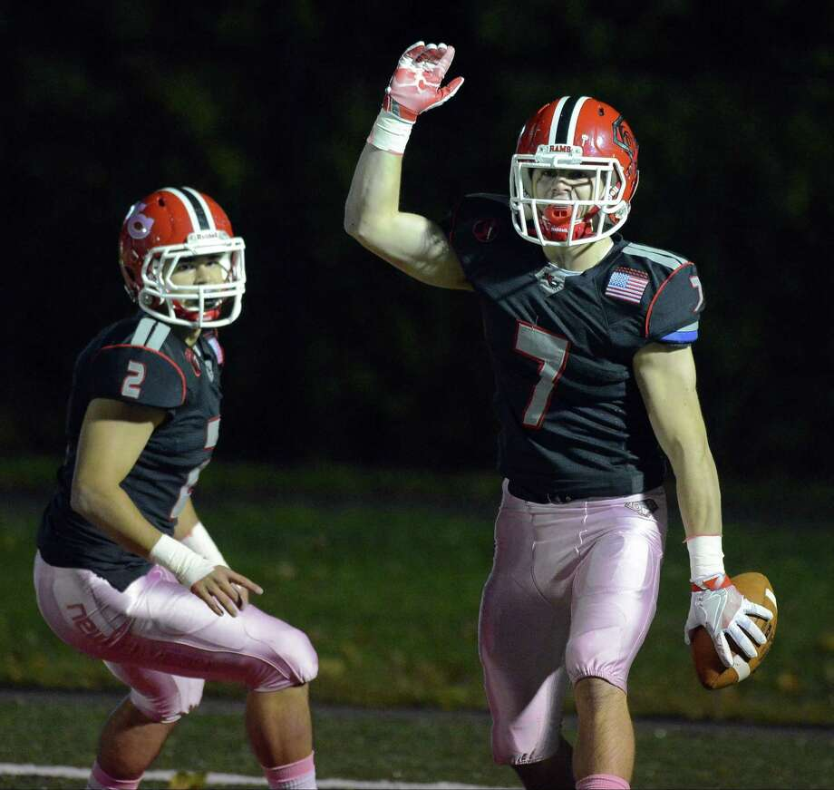 New Canaan Ryan O'Connell (7) celebrates his interception returned for a touchdown against Norwalk in a FCIAC varsity football game at New Canaan High School on Friday, Oct. 28, 2016. Photo: Matthew Brown / Hearst Connecticut Media / Stamford Advocate