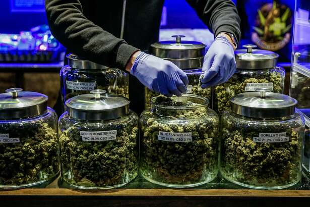 Budtender Alejandro Garcia (center), prepares an order of marijuana at cannabis dispensary The Green Cross, in San Francisco, California, on Tuesday, Nov. 1, 2016.