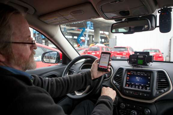 Aaron Small of Flywheel, the company that makes an e-hailing app for taxis, demos the new TaxiOS on Monday, Dec. 21, 2015 in San Francisco, Calif.