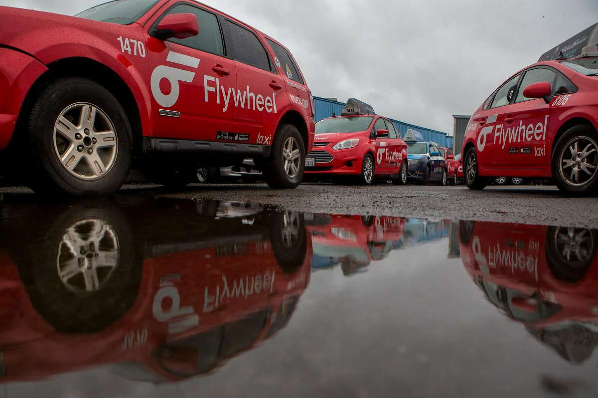 Flywheel taxis are seen on the lot on Monday, Dec. 21, 2015 in San Francisco, Calif.