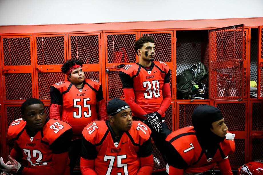 Kenneth Singleton, #30, (center, top), and his other teammates on the Eagles football team listen to their coach speak before the most important game of the season, at Kennedy High School, in Richmond, California, on Friday, Oct. 28, 2016. Kenneth Singleton was robbed at gunpoint and shot in the back two years, where he fell into a coma and struggled for his life. Photo: Gabrielle Lurie, The Chronicle