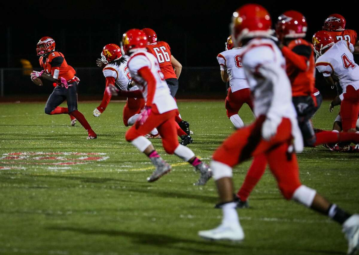Eagles player Micah Barnes, #3, (left) carries the ball down the field during a game against DeAnza high school, at Kennedy High School, in Richmond, California, on Friday, Oct. 28, 2016.