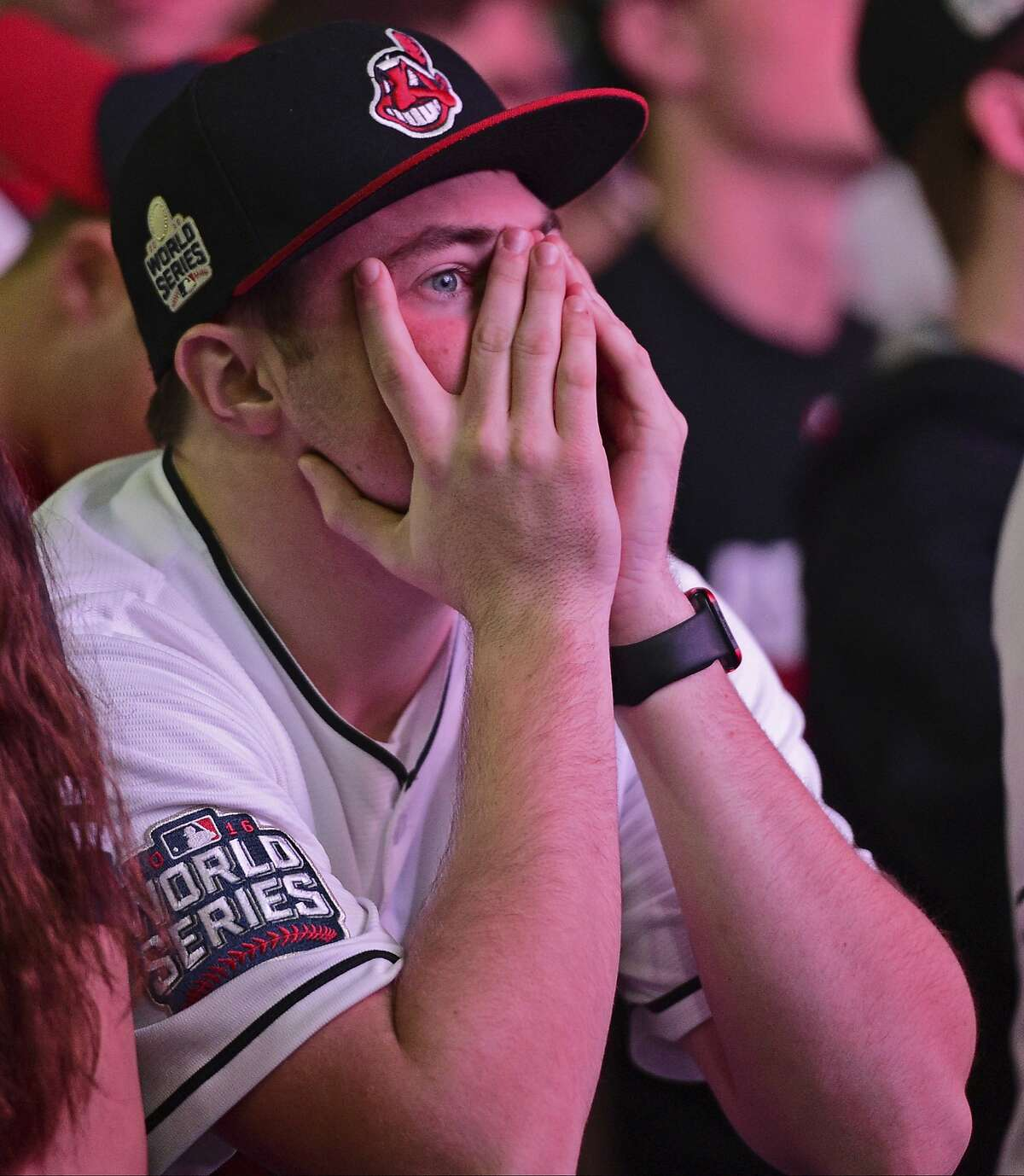 Cleveland Indians fan Ty Bailey reacts during a watch party for Game 6 of the baseball World Series between the Indians and the Chicago Cubs, outside Progressive Field, Tuesday, Nov. 1, 2016, in Cleveland. The Cubs won 9-3 to send the series to Game 7, (AP Photo/David Dermer)