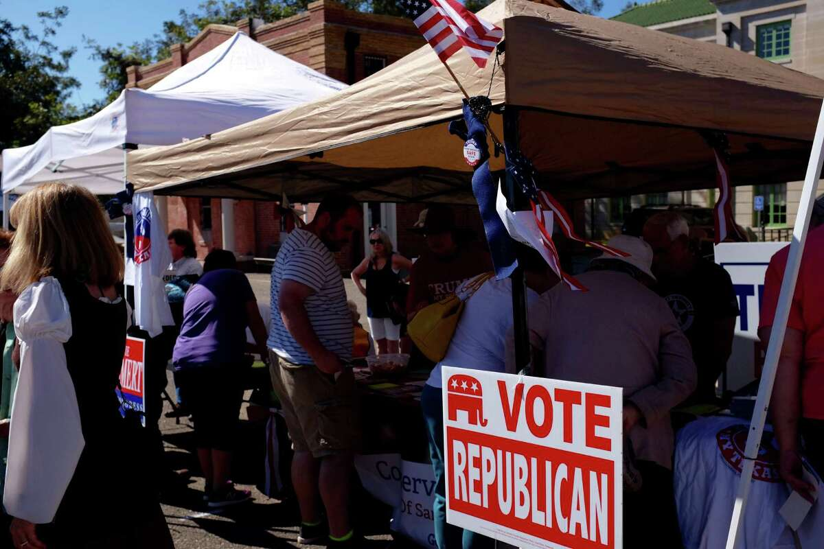 Members of San Augustine County's Republican club set up a table supporting Donald Trump at the Sassafras Festival in San Augustine in October.