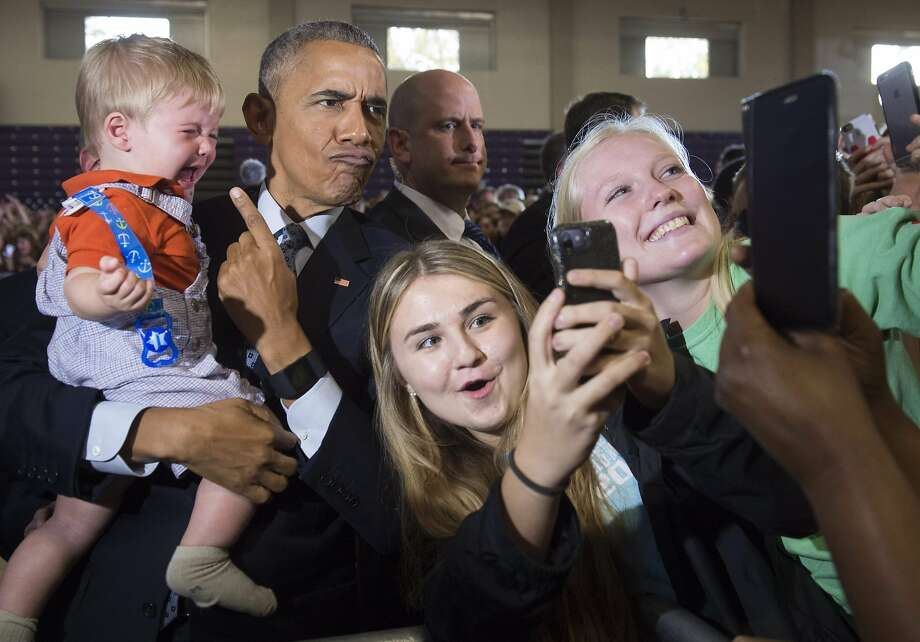 TOPSHOT - US President Barack Obama holds 10-month-old Brooks Breitwieser as he greets supporters after speaking to an overflow room during a Hillary for America campaign event for Democratic Presidential nominee Hillary Clinton at the Capital University Field House in Columbus, Ohio, November 1, 2016. / AFP PHOTO / SAUL LOEBSAUL LOEB/AFP/Getty Images Photo: SAUL LOEB, AFP/Getty Images