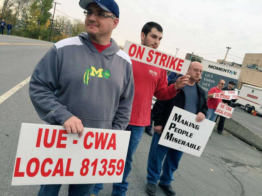Momentive employees walk the picket line Wednesday at the Waterford chemical plant after the union and the company failed to reach a contract agreement. (Cindy Schultz/Times Union)