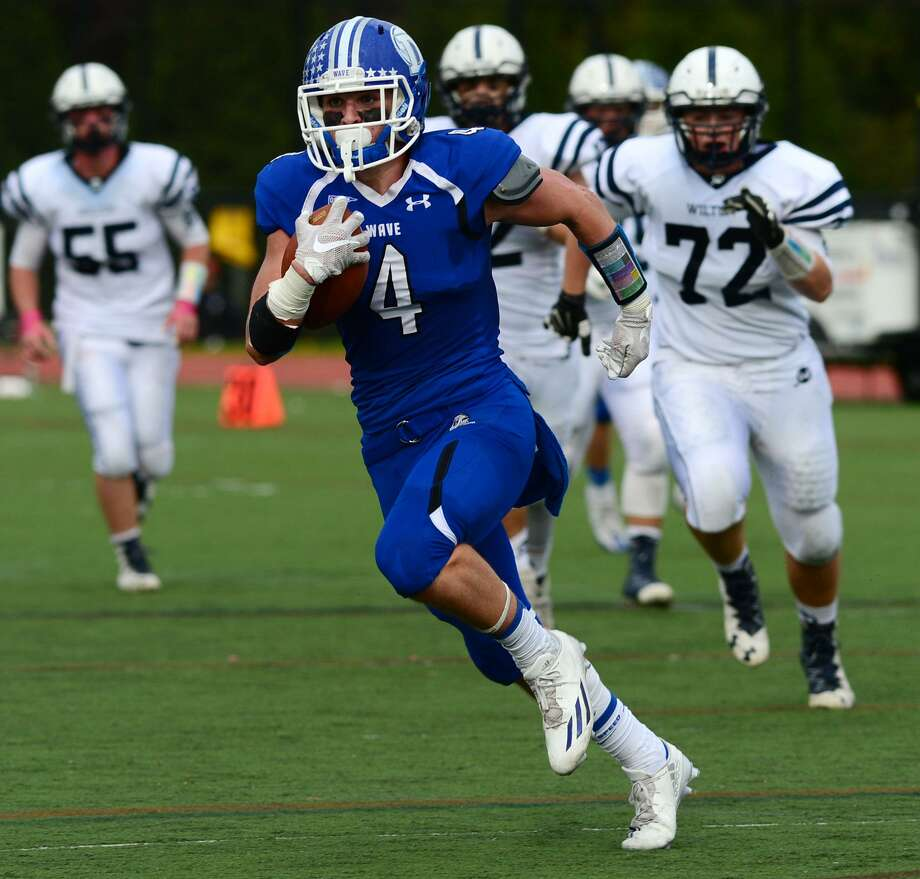 #4 for Darien, Max Grant, breaks away for long yardage as Darien High School takes on Wilton in their FCIAC football game Saturday, October 29, 2016, in Darien, Conn. Photo: Erik Trautmann / Hearst Connecticut Media / Norwalk Hour