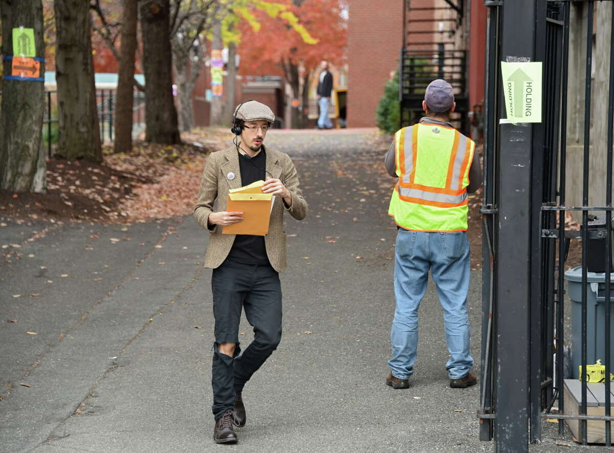 """Crew members walk back and for the on the set of the movie """"The Pretenders"""" which is being filmed at Russell Sage College on Wednesday, Nov. 2, 2016 in Troy, N.Y. (Lori Van Buren / Times Union)"""
