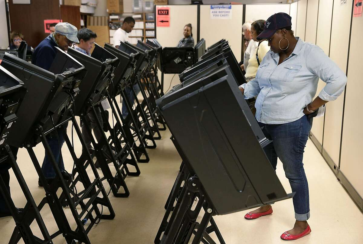 Voters cast their ballots during early voting for the 2016 general election at Forsyth County Government Center October 28, 2016 in Winston-Salem, North Carolina. Early voting has begun in North Carolina through November 5. (Photo by Alex Wong/Getty Images)