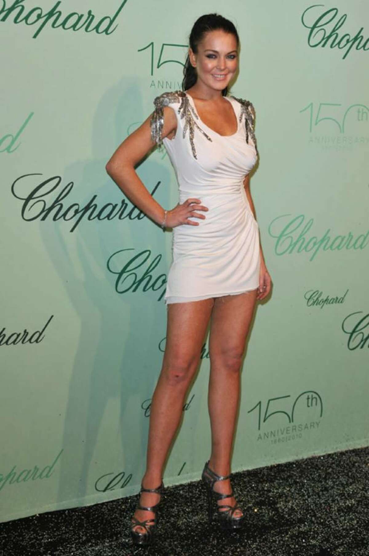 CANNES, FRANCE - MAY 17: Lindsay Lohan attends the Chopard 150th Anniversary Party at Palm Beach, Pointe Croisette during the 63rd Annual Cannes Film Festival on May 17, 2010 in Cannes, France. (Photo by Pascal Le Segretain/Getty Images) *** Local Caption *** Lindsay Lohan