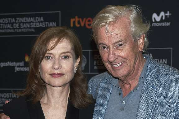 SAN SEBASTIAN, SPAIN - SEPTEMBER 19:  Actress Isabelle Huppert and director Paul Verhoeven attend 'Elle' premiere during 64th San Sebastian International Film Festival at Victoria Eugenia Teather on September 19, 2016 in San Sebastian, Spain.  (Photo by Carlos Alvarez/Getty Images)