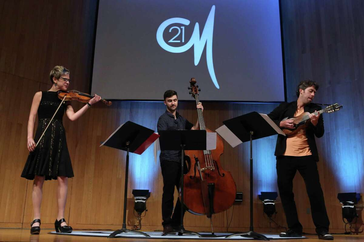 From left to right, violinist Sara Caswell, bassist Andrew Ryan and mandolinist Joe Brent of 9 Horses perform at Wilton Library's Hot & Cool: Jazz at the Brubeck Room concert on Sunday, Nov. 13, at 4 p.m.