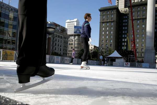 A skater steps onto the ice as soon as the Union Square skating rink opens for the holiday season in San Francisco, Calif. on Wednesday, Nov. 2, 2016.