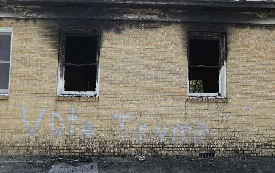 """""""Vote Trump"""" is spray-painted on the side of the fire-damaged Hopewell Baptist Church in Greenville, Miss. Firefighters found flames and smoke pouring from the church sanctuary. Photo: Rogelio V. Solis, Associated Press"""