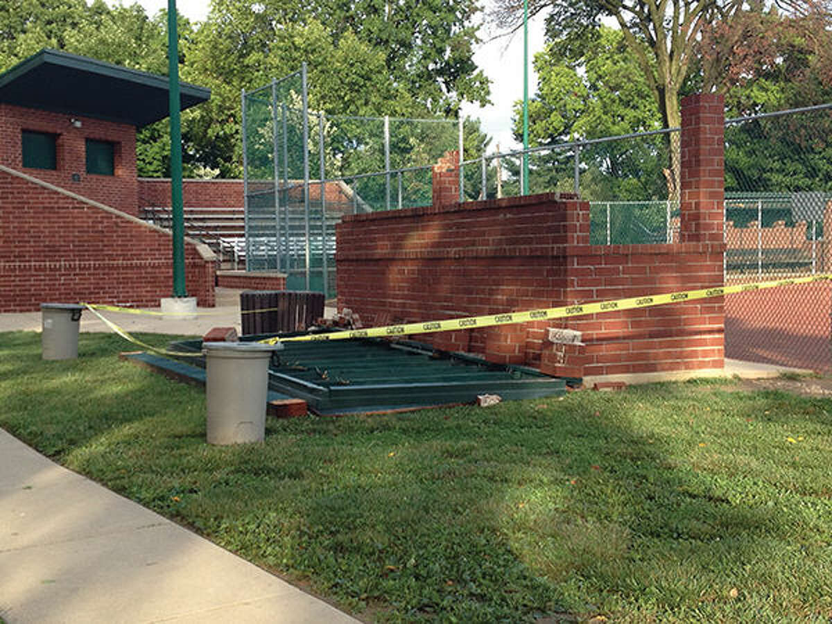 The roof of the first base dugout at Leclaire Field was blown off by the wind.