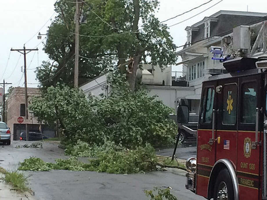 A tree blocks East College between Wildey Theatre and Weber and Rodney Funeral Home.