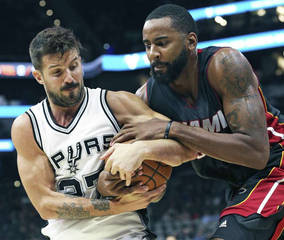Nicolas Laprovittola wrestles the ball away from Keith Benson as the Spurs host Miami at the AT&T Center on October 14, 2016.
