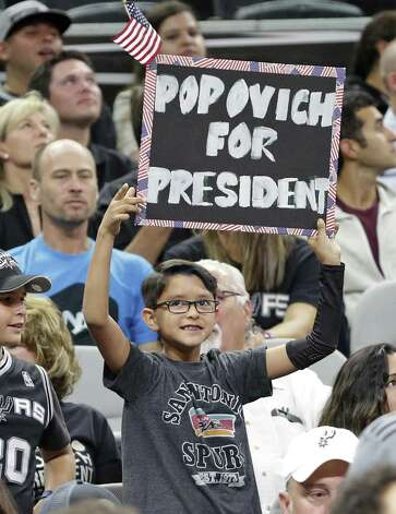 A young fan displays his feelings about the coach as the Spurs host the Pelicans at the AT&T Center on October 29, 2016. Photo: Tom Reel, Staff / San Antonio Express-News / 2016 SAN ANTONIO EXPRESS-NEWS