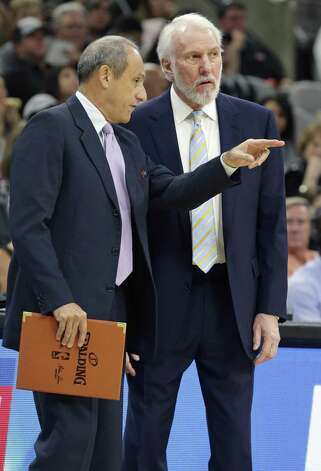 Greg Popovic listens to observations of Ettore Messina as the Spurs host the Pelicans at the AT&T Center on October 29, 2016. Photo: Tom Reel, Staff / San Antonio Express-News / 2016 SAN ANTONIO EXPRESS-NEWS