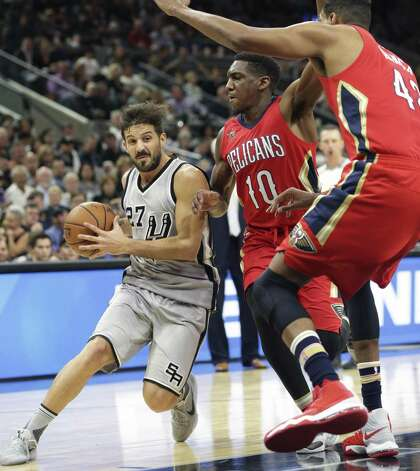 Nico Laprovittola draws the defense to the hoop as the Spurs host the Pelicans at the AT&T Center on October 29, 2016. Photo: Tom Reel, Staff / San Antonio Express-News / 2016 SAN ANTONIO EXPRESS-NEWS