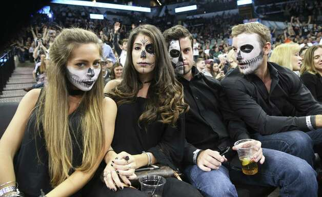 Courtside fans Amy Duncan, Victoria Jasso, Weston Schroeder and Dylan Howell keep a straight face in the second half as the Spurs host the Pelicans at the AT&T Center on October 29, 2016. Photo: Tom Reel, Staff / San Antonio Express-News / 2016 SAN ANTONIO EXPRESS-NEWS