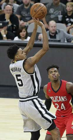 Dejounte Murray goes up for a jumper in the second half as the Spurs host the Pelicans at the AT&T Center on October 29, 2016. Photo: Tom Reel, Staff / San Antonio Express-News / 2016 SAN ANTONIO EXPRESS-NEWS