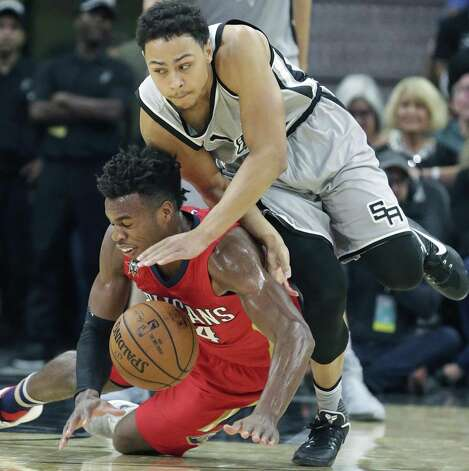 Bryn Forbes aggressively claims a loose ball from  Buddy Hield as the Spurs host the Pelicans at the AT&T Center on October 29, 2016. Photo: Tom Reel, Staff / San Antonio Express-News / 2016 SAN ANTONIO EXPRESS-NEWS