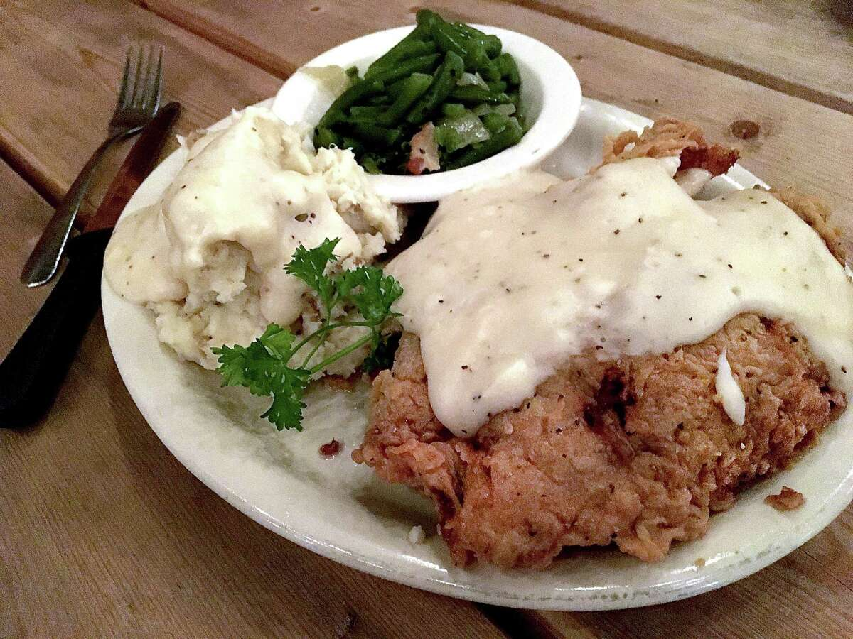 Hand-breaded chicken-fried steak includes a choice of sides. Here, it's served with mashed potatoes and green beans.