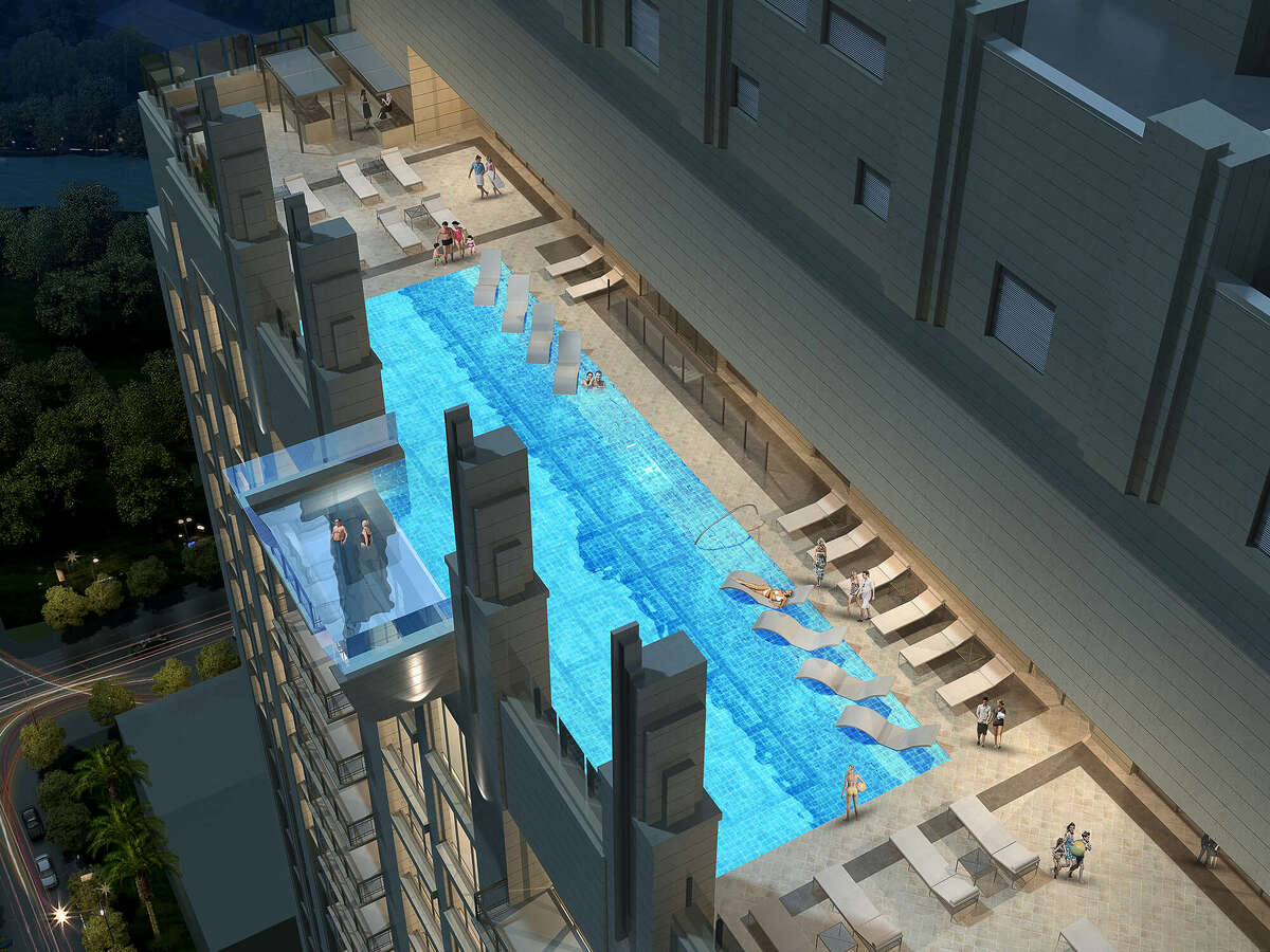 Only part of the pool is cantilevered, so that it sticks off the building's edge. (Architects' rendering.)