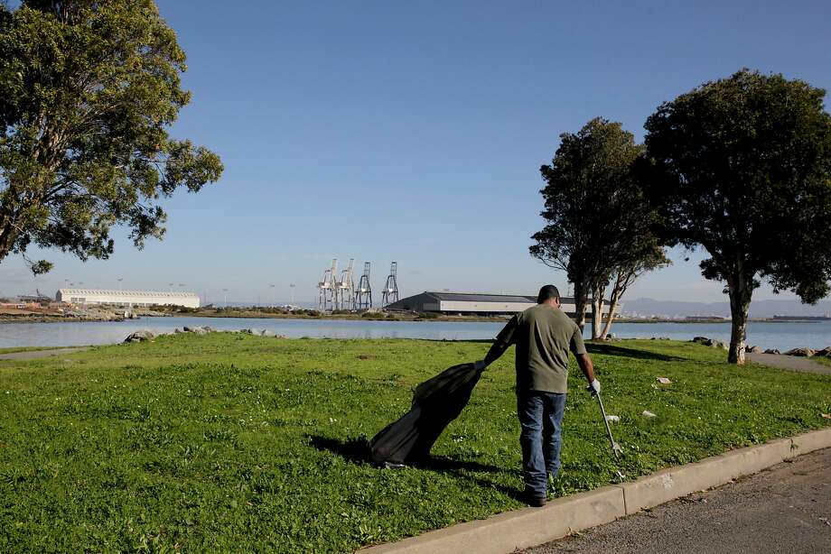 Top: A gardener for San Francisco's Recreation and Park Department picks up trash at India Basin Shoreline Park, the second-lowest-ranked park in the city. Photo: Gabriella Angotti-Jones, The Chronicle