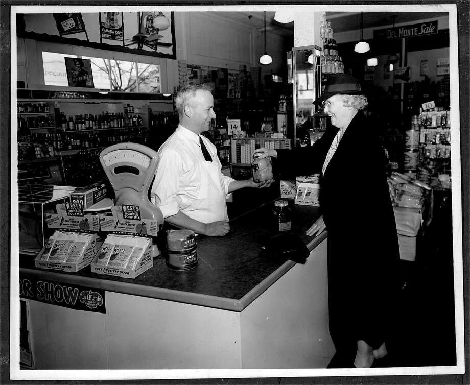 Frank Adronico checks out a customer at the original Andronico's market on Solano Ave. in Berkeley in 1933. Photo: SFC