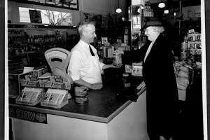 Frank Adronico checks out a customer at the original Andronico's market on Solano Ave. in Berkeley in 1933.