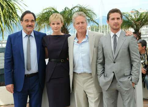CANNES, FRANCE - MAY 14:  (Left to Right) Director Oliver Stone,actress Carey Mulligan, actor Michael Douglas with Shia Labeouf attend the 'Wall Street: Money Never Sleeps' Photocall at the Palais des Festivals during the 63rd Annual Cannes Film Festival on May 14, 2010 in Cannes, France.  (Photo by Francois Durand/Getty Images) *** Local Caption *** Oliver Stone;Michael Douglas;Carey Mulligan;Shia Labeouf Photo: Francois Durand, Getty Images / 2010 Getty Images