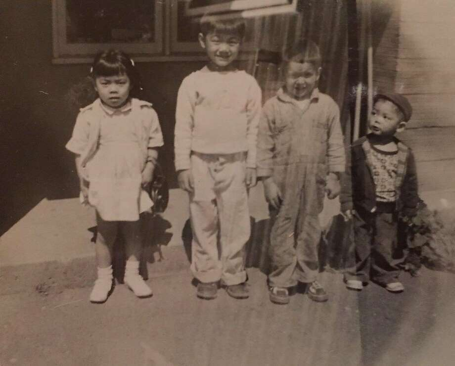 San Francisco Mayor Ed Lee as a 3-year-old (far right) with his siblings, left to right,�Sharon, Carl and Manny, in the Seattle housing project where they lived Photo: Ed Lee Family, Courtesy Photo