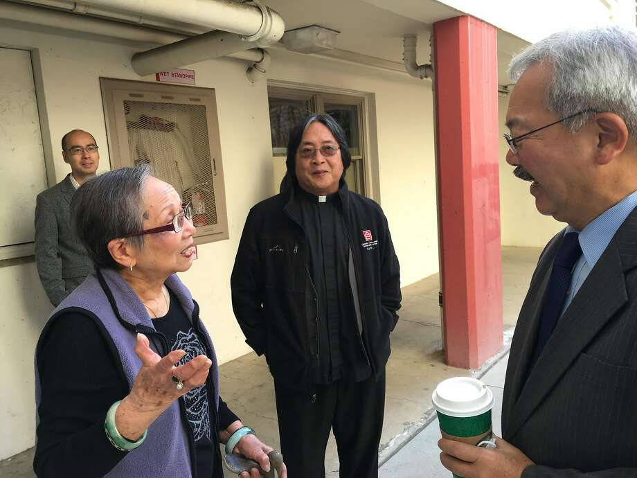 Chang Jok Lee, 89, talks to Mayor Ed Lee about the Ping Yuen apartments, where she has lived since the public housing project opened in 1952. Photo: Photo Credit: Deirdre Hussey