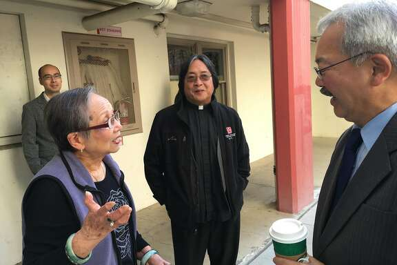 Chang Jok Lee, 89,  talks to Mayor Ed Lee and has lived in Ping Yuen since 1952, when they opened. Photo Credit: Deirdre Hussey