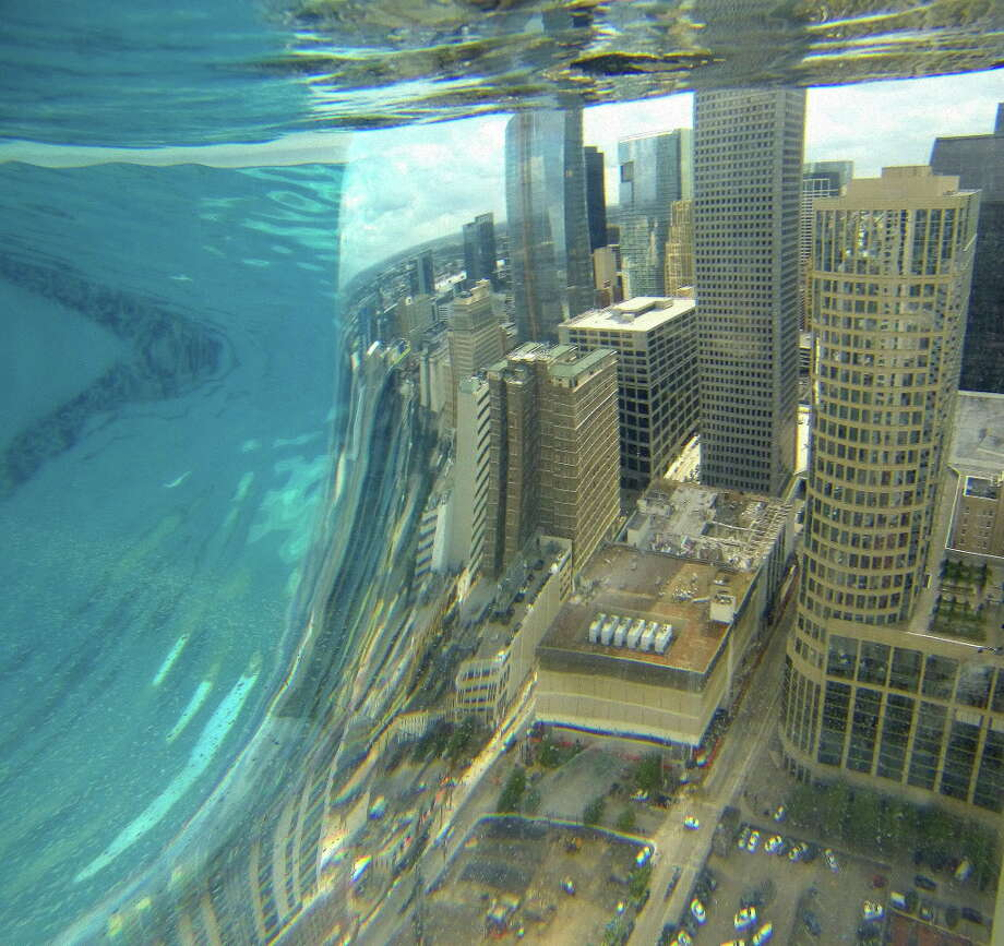 But there's nothing in the world like the skyline view from inside the pool itself.  Photo: Karen Warren/Houston Chronicle