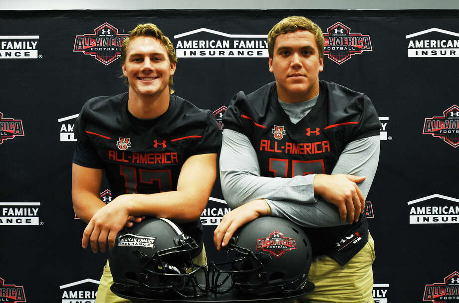 Cy-Fair offensive linemen Brock Wright (left) and Austin Deculus (right) sport their Under Armour All-America game jerseys. Both players are highly-touted D1 commits, and are enrolling early at Notre Dame and LSU, respectively. Photo: Tony Gaines / HCN