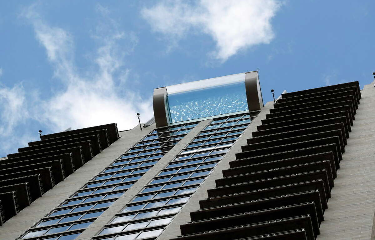 Market Square Tower's sky pool, on the 42 floor of the luxury apartment complex, at 777 Preston Street, featuring a glass-bottom, infinity pool.