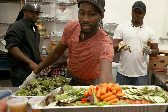 Owner/chef O�Brian Matterson makes salad as he fulfills catering orders for his Jamaican food in the kitchen on Friday, October 27, 2016, in Richmond, Calif.