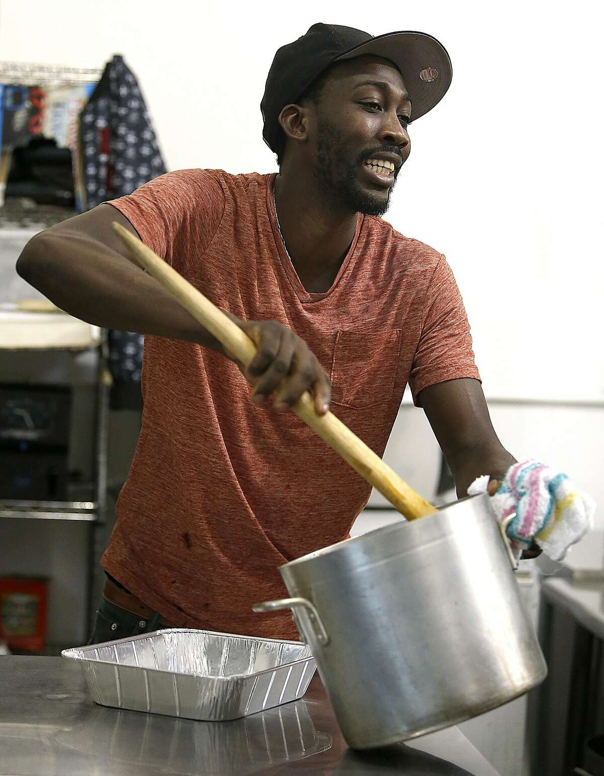 Owner/chef O�Brian Matterson stirs lentil beans as he fulfills catering orders for Jamaican food in the kitchen on Friday, October 27, 2016, in Richmond, Calif.