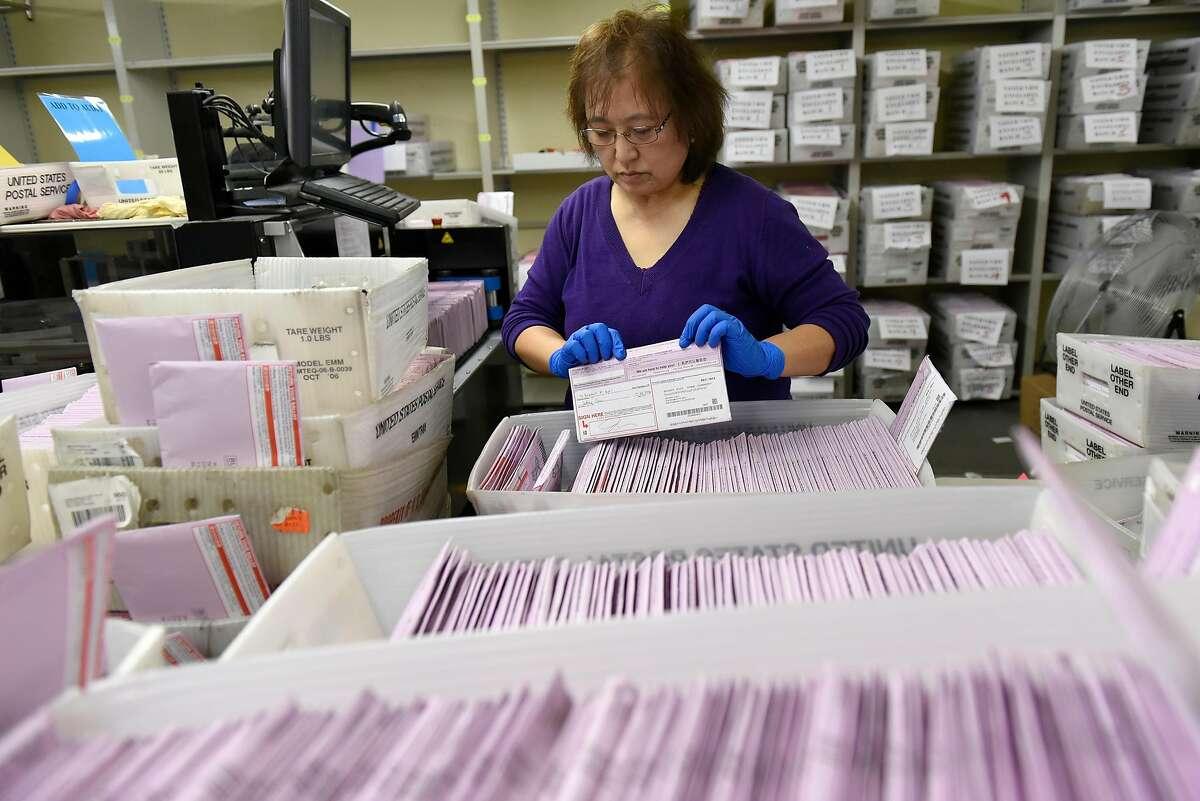Election clerk Sachi Manalisay sorts mail in ballots in a sorting room at City Hall in San Francisco, CA, November 2, 2016.