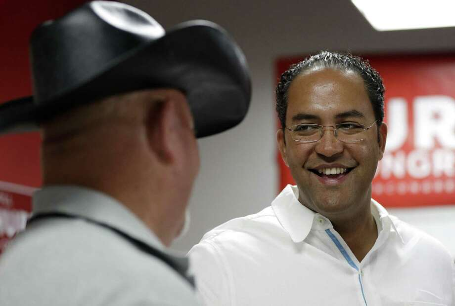 FILE - In this Aug. 27, 2016, file photo, first-term Republican Rep. Will Hurd, right, of Texas, talks with a supporter at a campaign office in San Antonio. Hurd faces former Democratic Rep. Pete Gallego in Texas' 23rd District, which spans 58,000-plus square miles, making it larger than 29 states. (AP Photo/Eric Gay, File) Photo: Eric Gay /Associated Press / Copyright 2016 The Associated Press. All rights reserved.